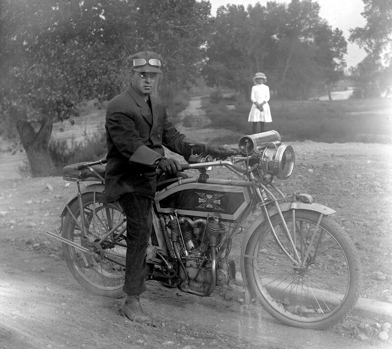 Man on a motorcycle 'Excelsior Autocycle' by the Archer Canal bridge in Denver, Colorado, between 1910 and 1915