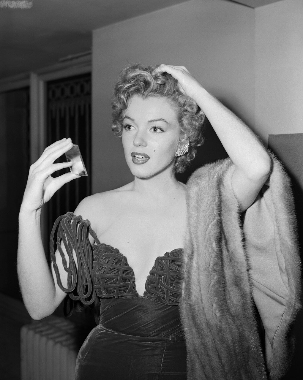 Marilyn Monroe Checking Her Appearance
