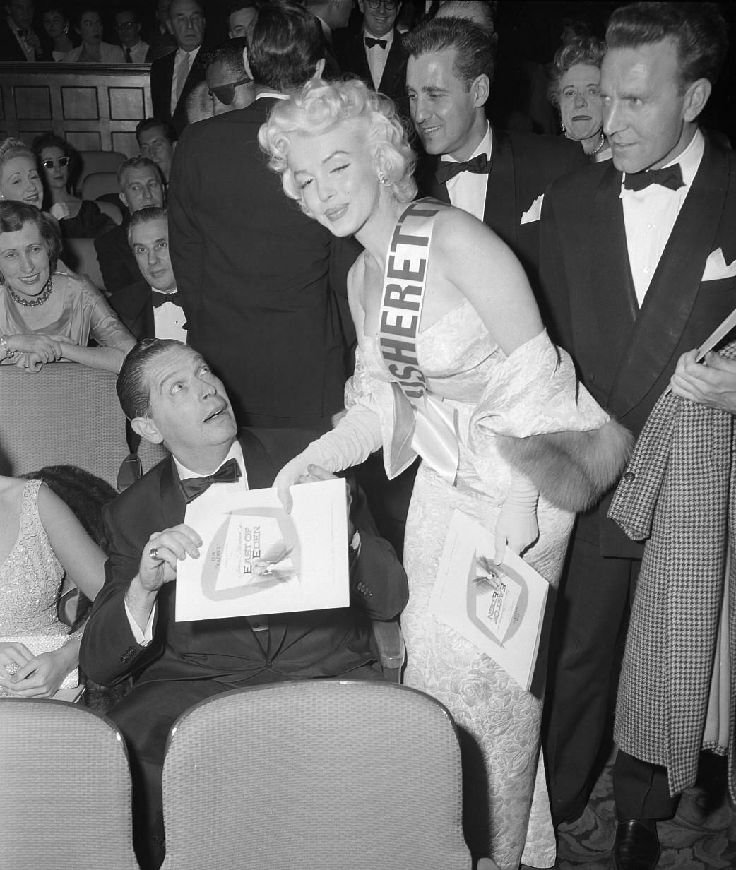 Marilyn Monroe Gives Milton Berle a Program