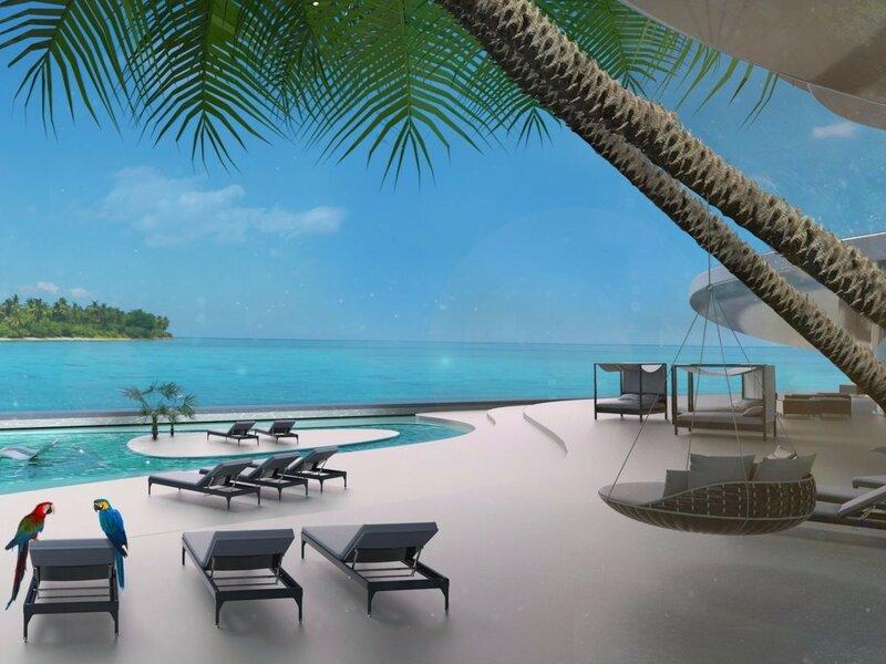 На живописной пляжной палубе есть множество бассейнов, площадок для барбекю, подводная столовая, станция для кормления акул и кинотеатр на открытом воздухе.