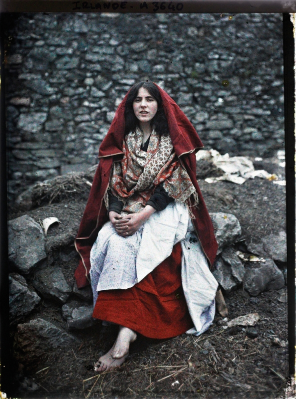 Main Ní Tuathail, a 14 year old girl from the Claddagh wearing traditional Claddagh dress. Galway, Ireland, 26th May 1913. One of the first colour photographs taken in Ireland.png