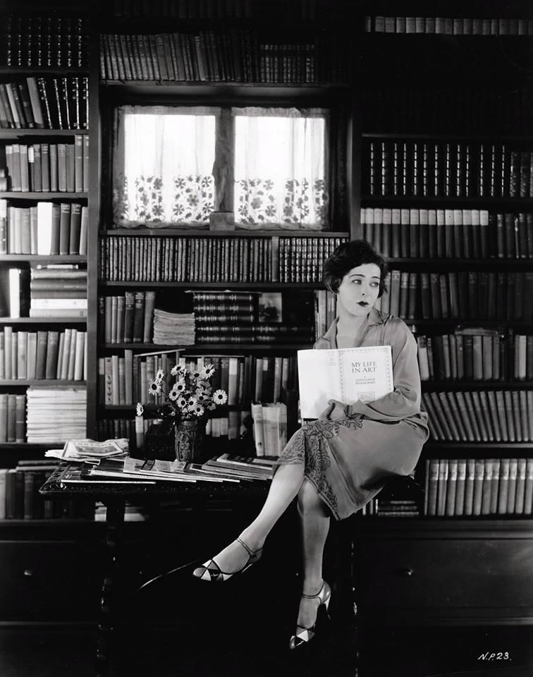 Alla Nazimova in her library holding a copy of Constanin Stanislavski's memoir, My Life In Art.jpg