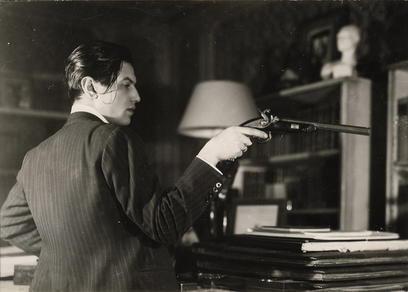 Serge Lifar with the handgun which was used in the duel between Alexander Pushkin and Georges d'Anthès.jpg