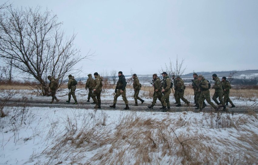 "Pro-Russian separatists from the Chechen ""Death"" battalion walk during a training exercise in the territory controlled by the self-proclaimed Donetsk People's Republic"