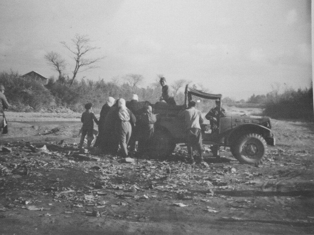 Japanese sorting garbage, Fukuoka, Feb 1946