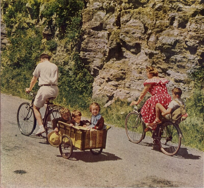 1951 France Sunday Drivers Take to the Open Road with Bikes and Trailers by Walter Edwards.jpg