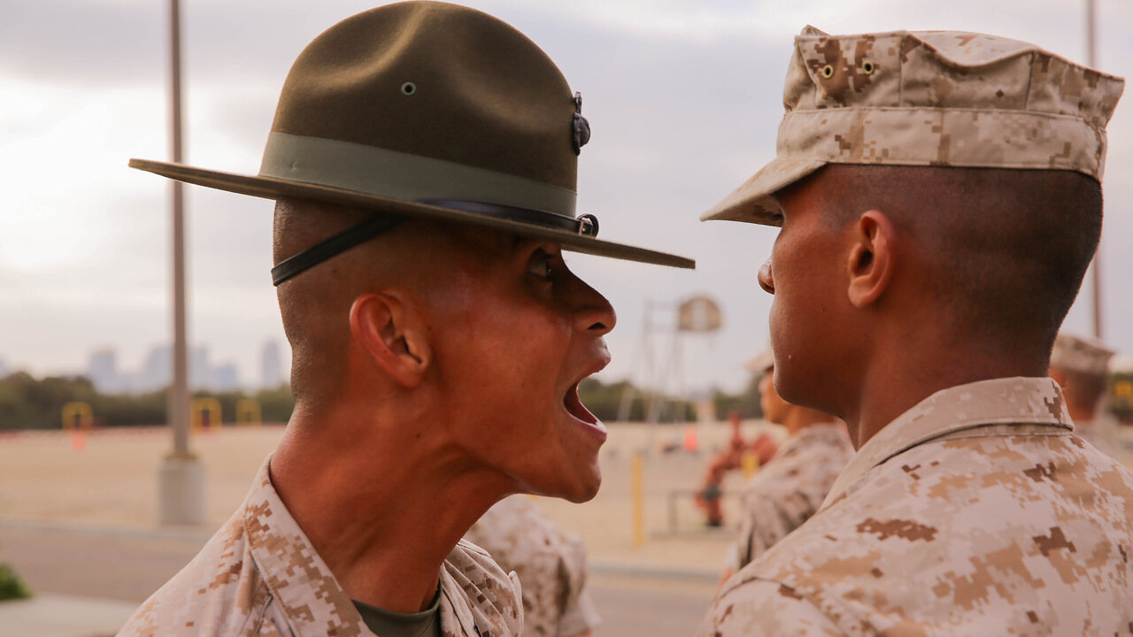 A Recruit of India Company, 3rd Recruit Training Battalion, stands at attention as he is inspected by a drill instructor during the senior drill instructor's inspection at Marine Corps Recruit Depot San Diego, Sept. 5.2014.jpg