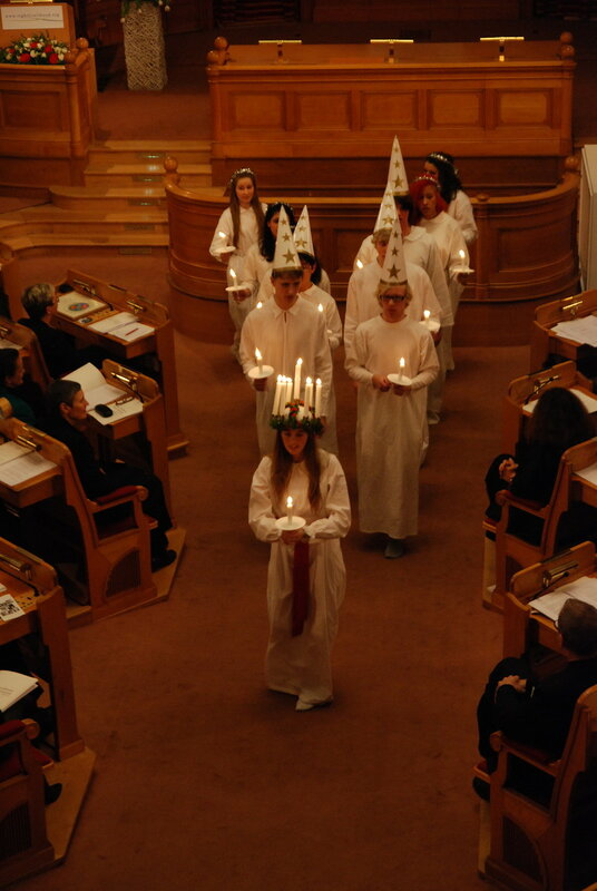 Lucia procession at a meeting. The so-called star boys follow Lucia in the procession.