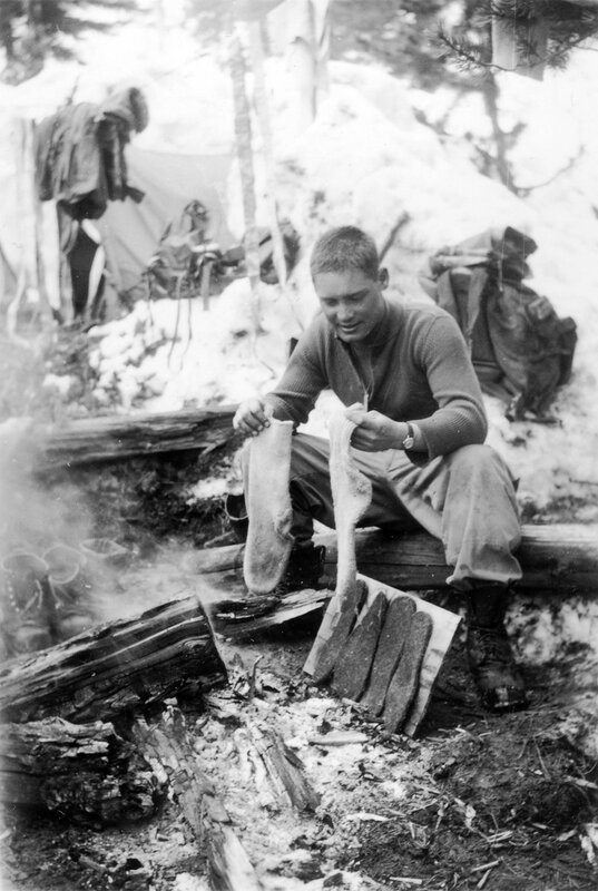 1944 April. Hugh Evans drying his socks and innersoles bivouac area