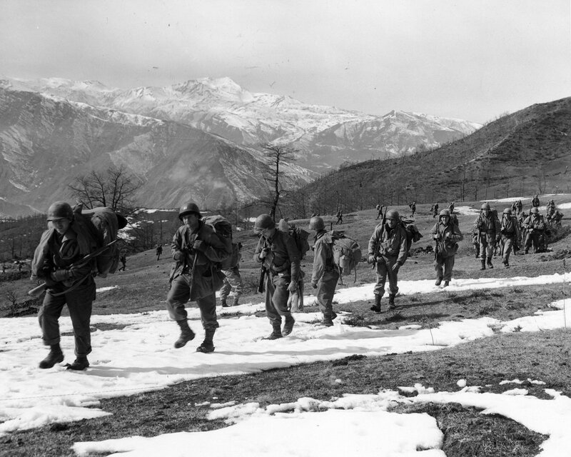 February 21, 1945. Reinforcements move up the ridge, Mount Belvedere in background, Italy