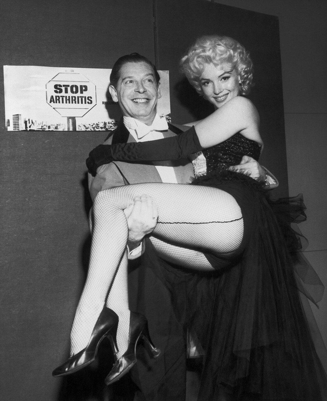 Milton Berle Lifting Marilyn Monroe