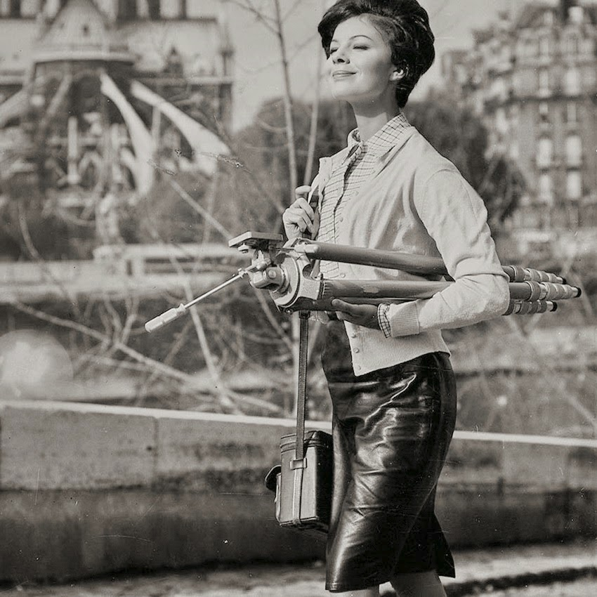 Lady photographer with heavy tripod (1960s, France) Photographer unknown