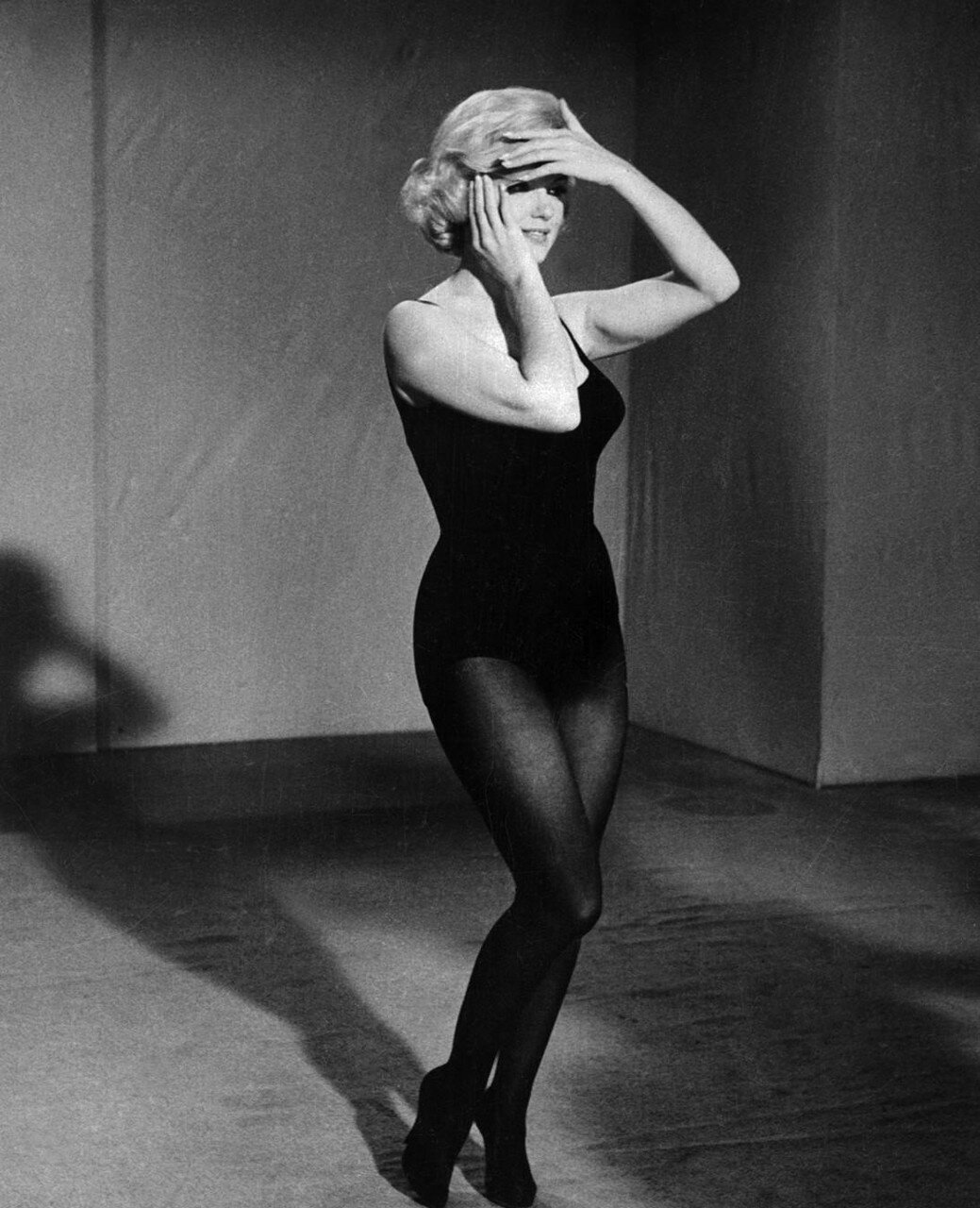 Marilyn Monroe Posing with Hands to Her Face