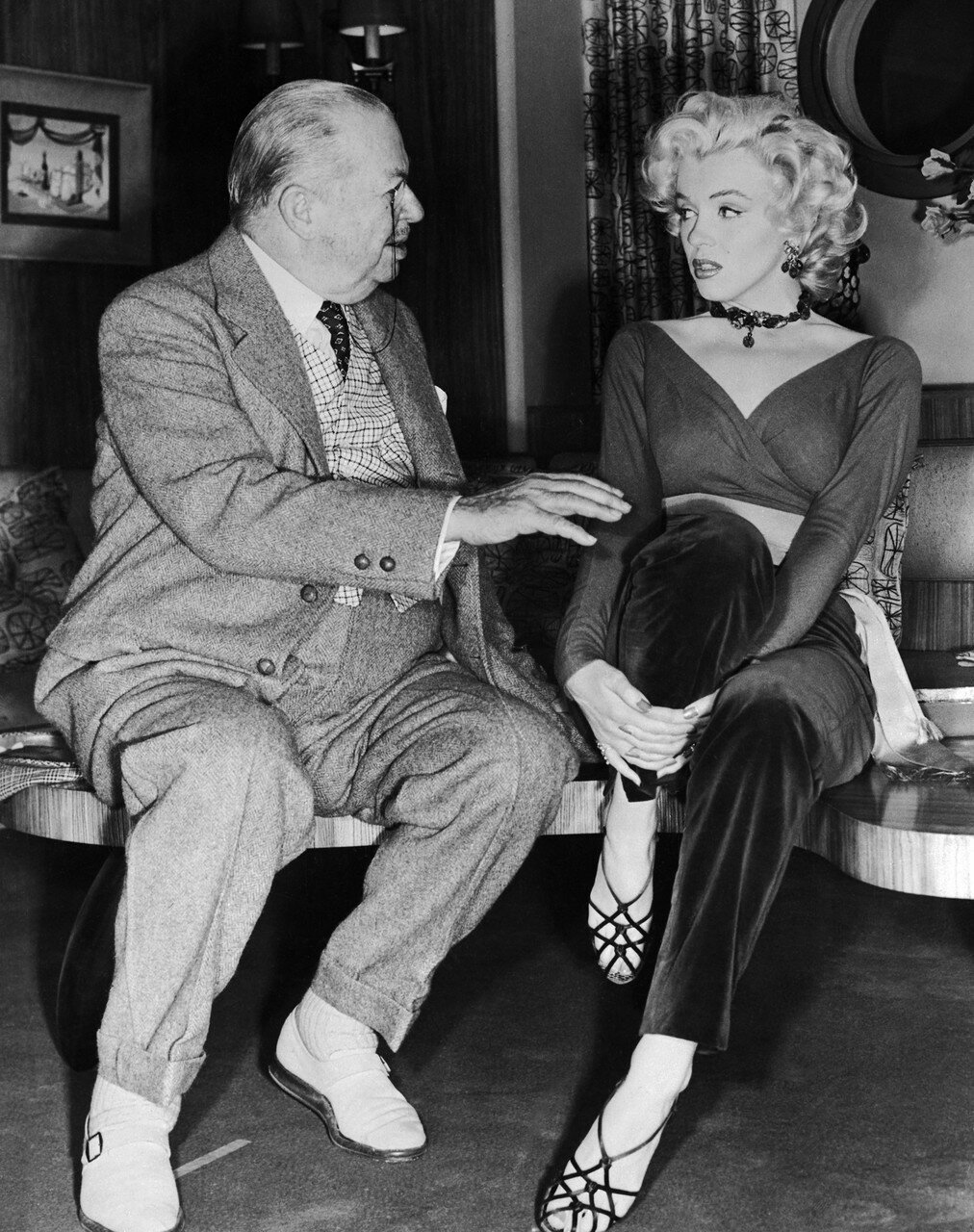 Marilyn Monroe and Charles Coburn Sitting and Talking