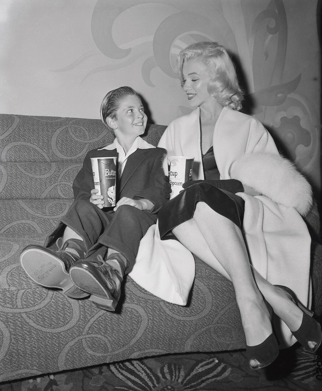 Actor Tommy Rettig and Actress Marilyn Monroe
