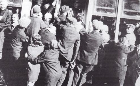 Struggling for a tram in Vitebsk, Belarus; 1920s.jpg