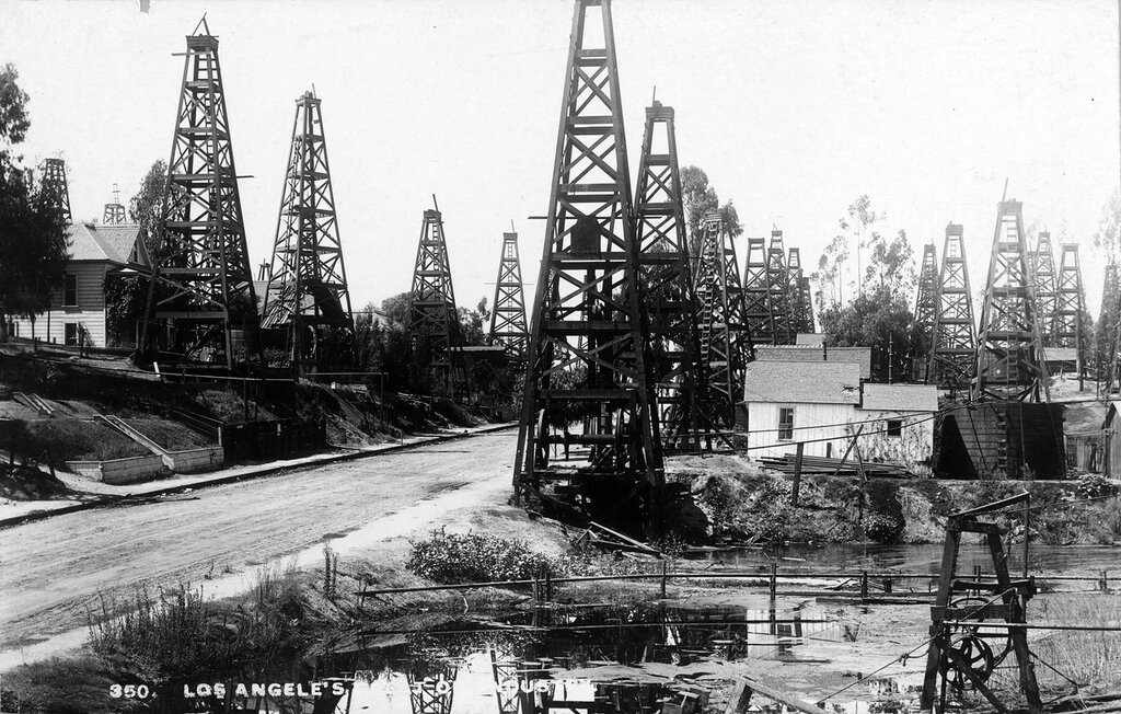 Los Angele's [sic] major industry. View of oil derricks and utility buildings near a street in Los Angeles, California, 1896