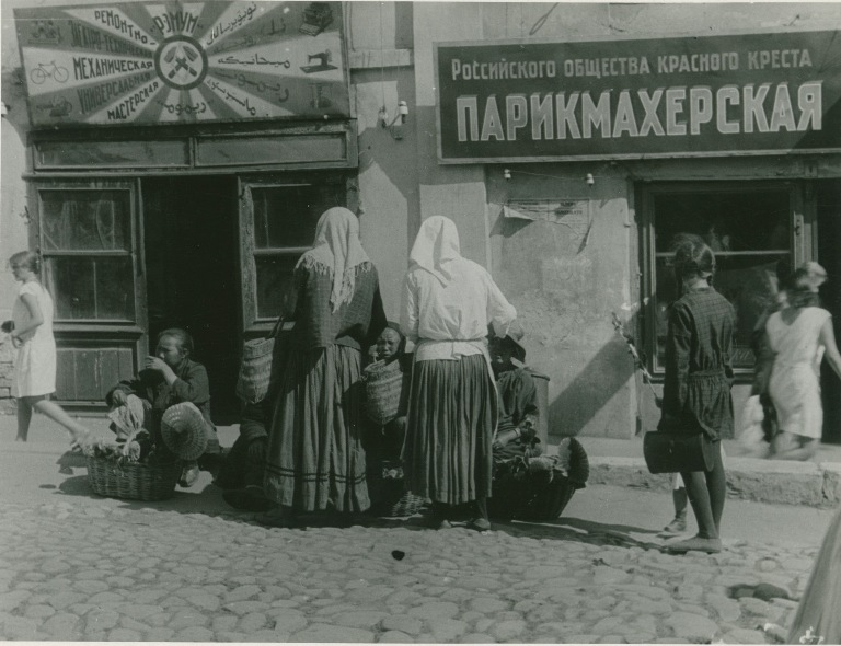 In front of a repair shop and barbershop in Kazan', 1930.jpg