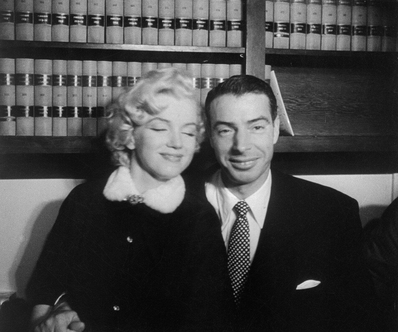 Marilyn Monroe Sitting with Joe DiMaggio