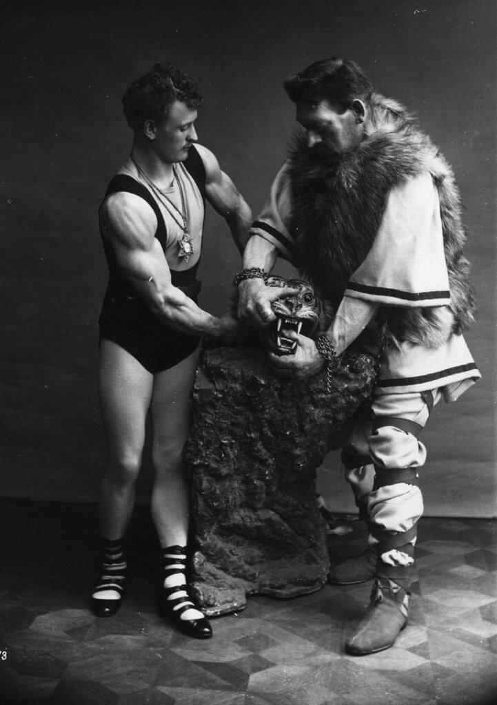 Eugene Sandow and Goliath wrestling with 'a bear.' (1910).jpg