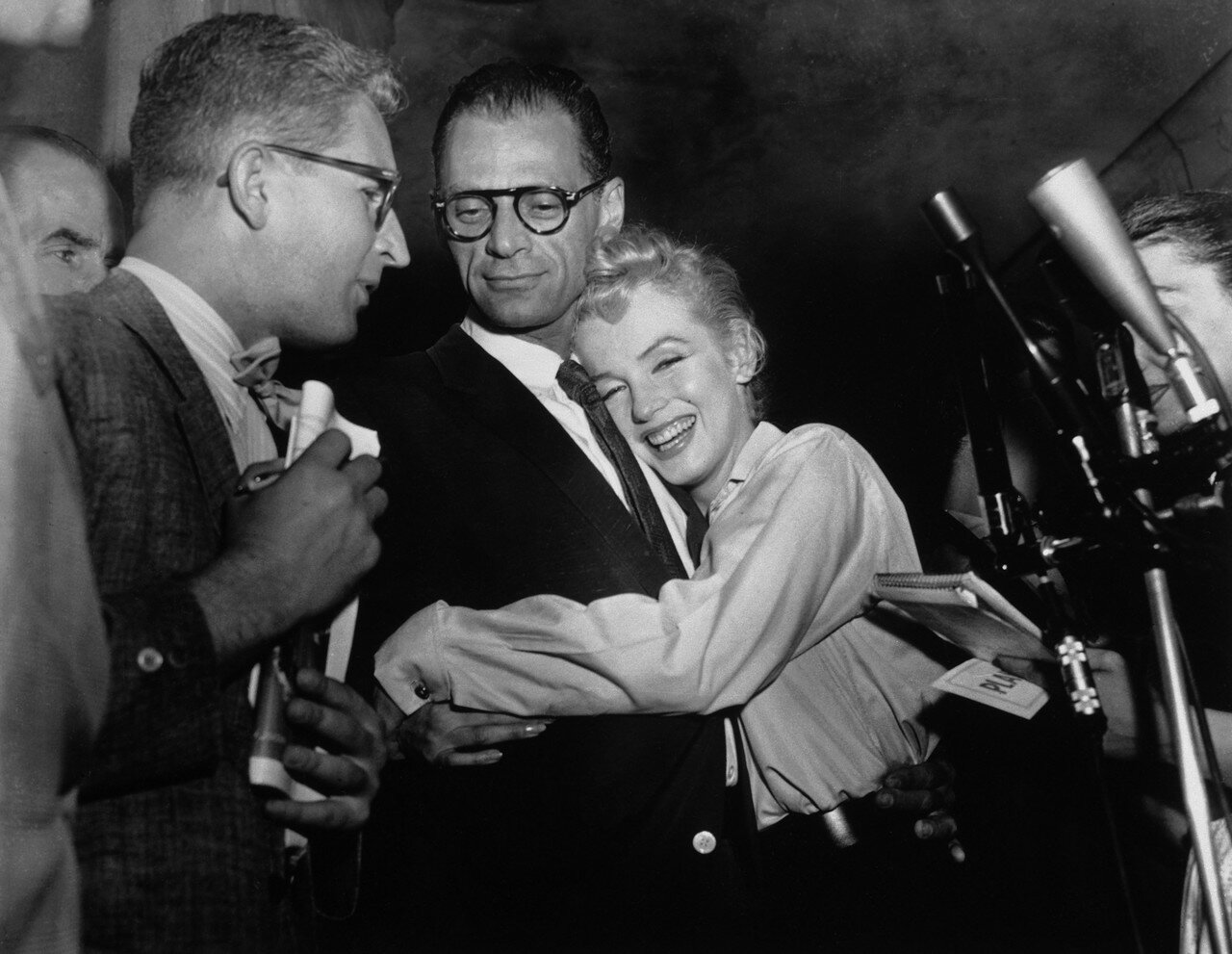 Actress Marilyn Monroe Hugging Arthur Miller