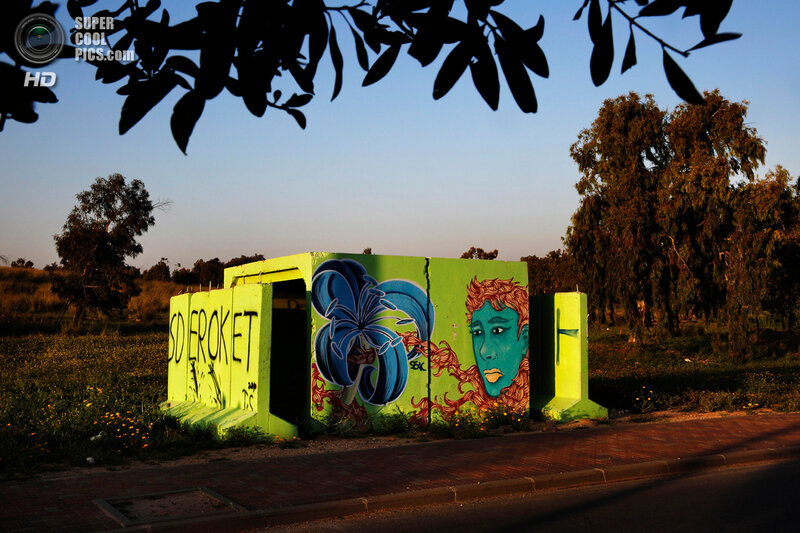 A decorated concrete bomb shelter on the roadside in the Israeli town of Sderot