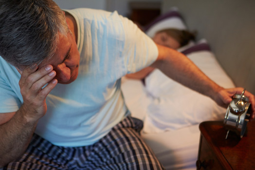 Man Awake In Bed Suffering With Insomnia
