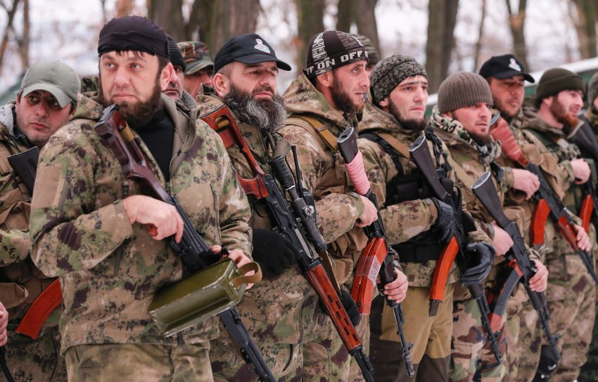 "Pro-Russian separatists from the Chechen ""Death"" battalion stand in a line during a training exercise in the territory controlled by the self-proclaimed Donetsk People's Republic"