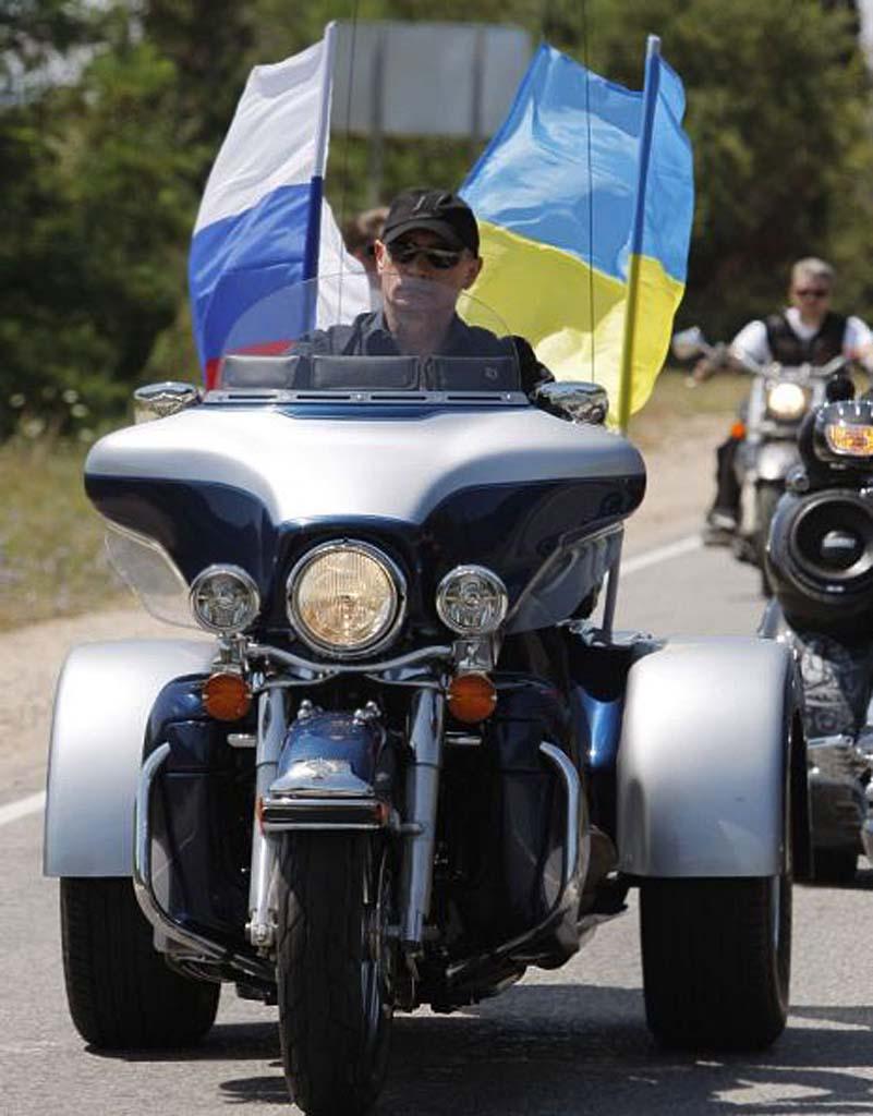 Russia's Prime Minister Vladimir Putin rides a Harley Davidson Lehman Trike