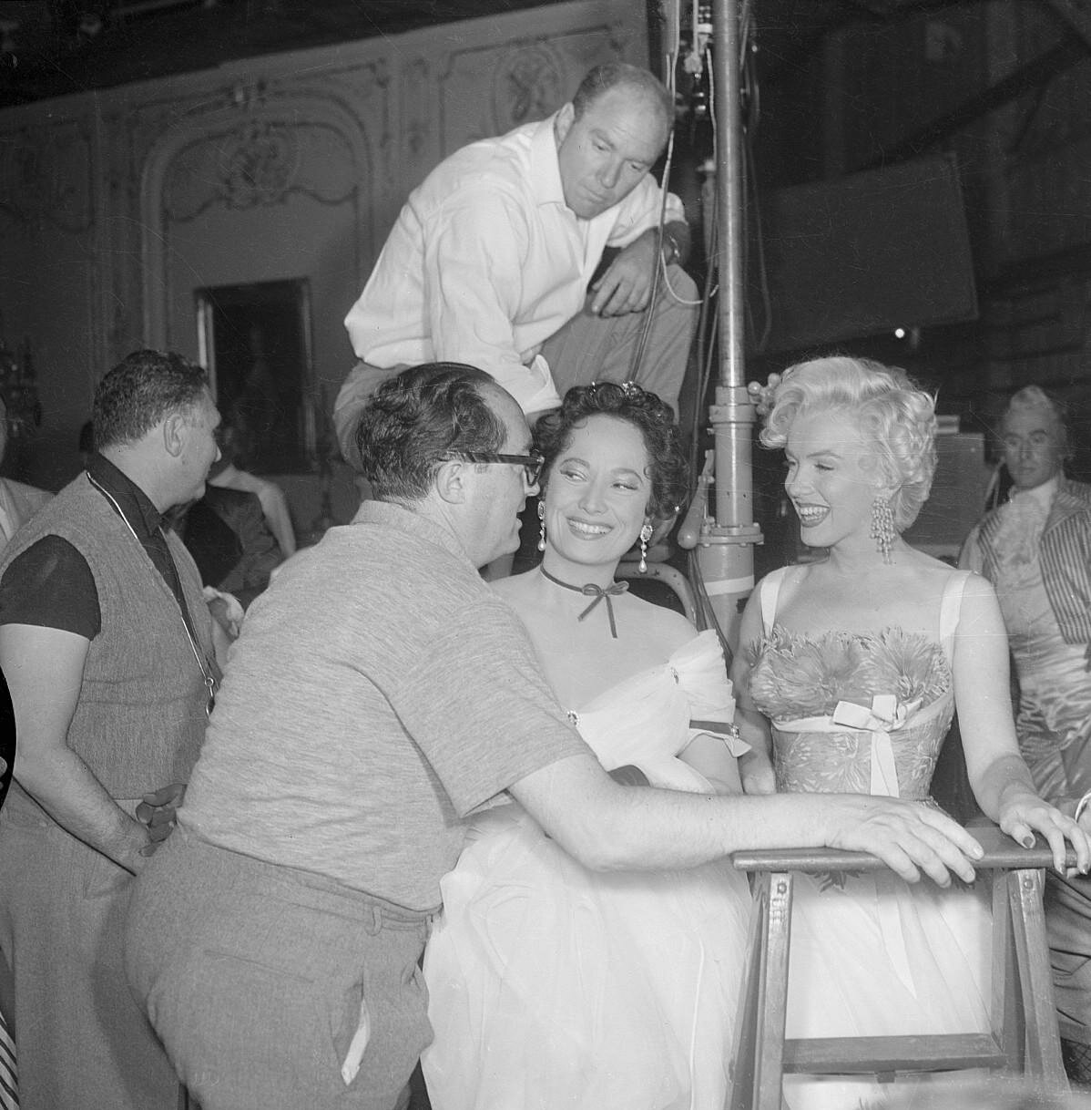 Director Henry Koster Joking with Marilyn Monroe