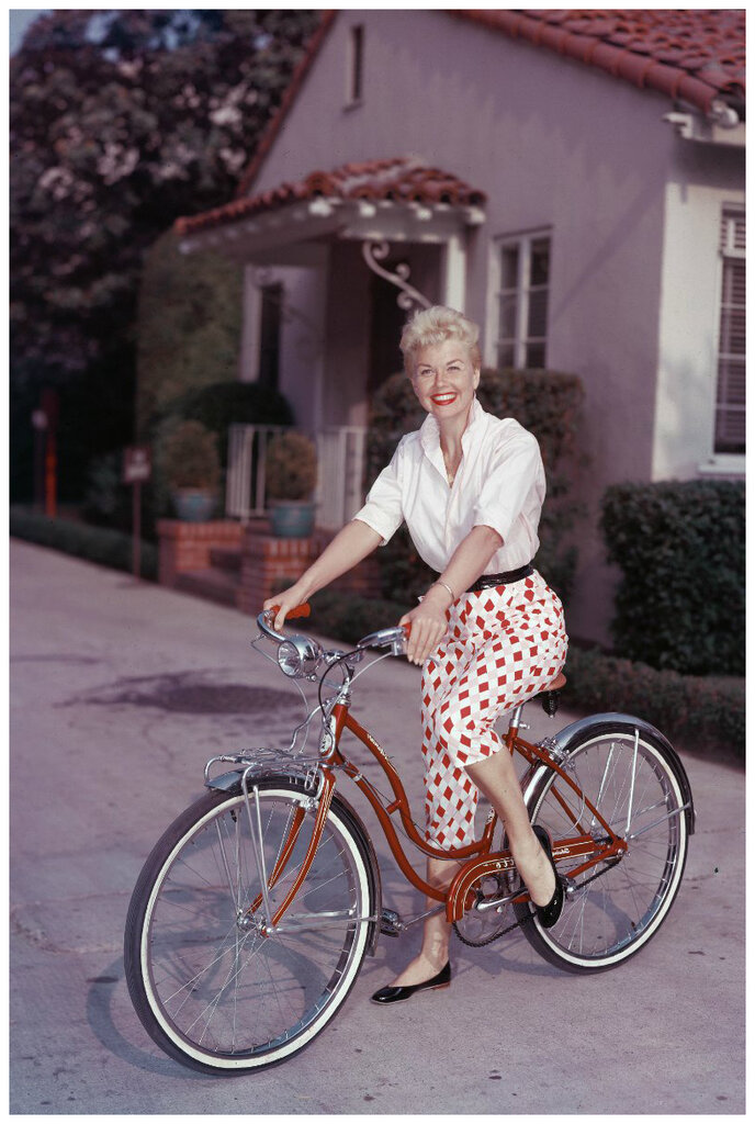 1955 Doris Day poses on a red Schwinn bicycle by Hulton Archive.jpg