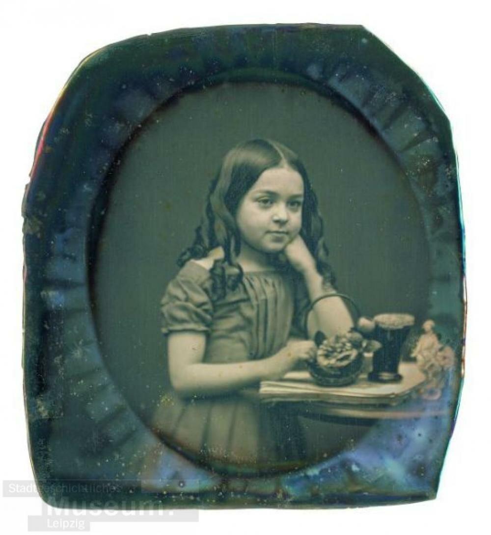 1850-е. Девочка за столом.