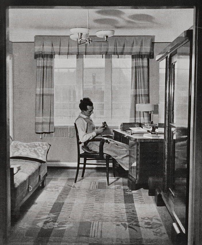 Walter Hollnagel. Inspecting a new camera. Antona, 1936.jpg