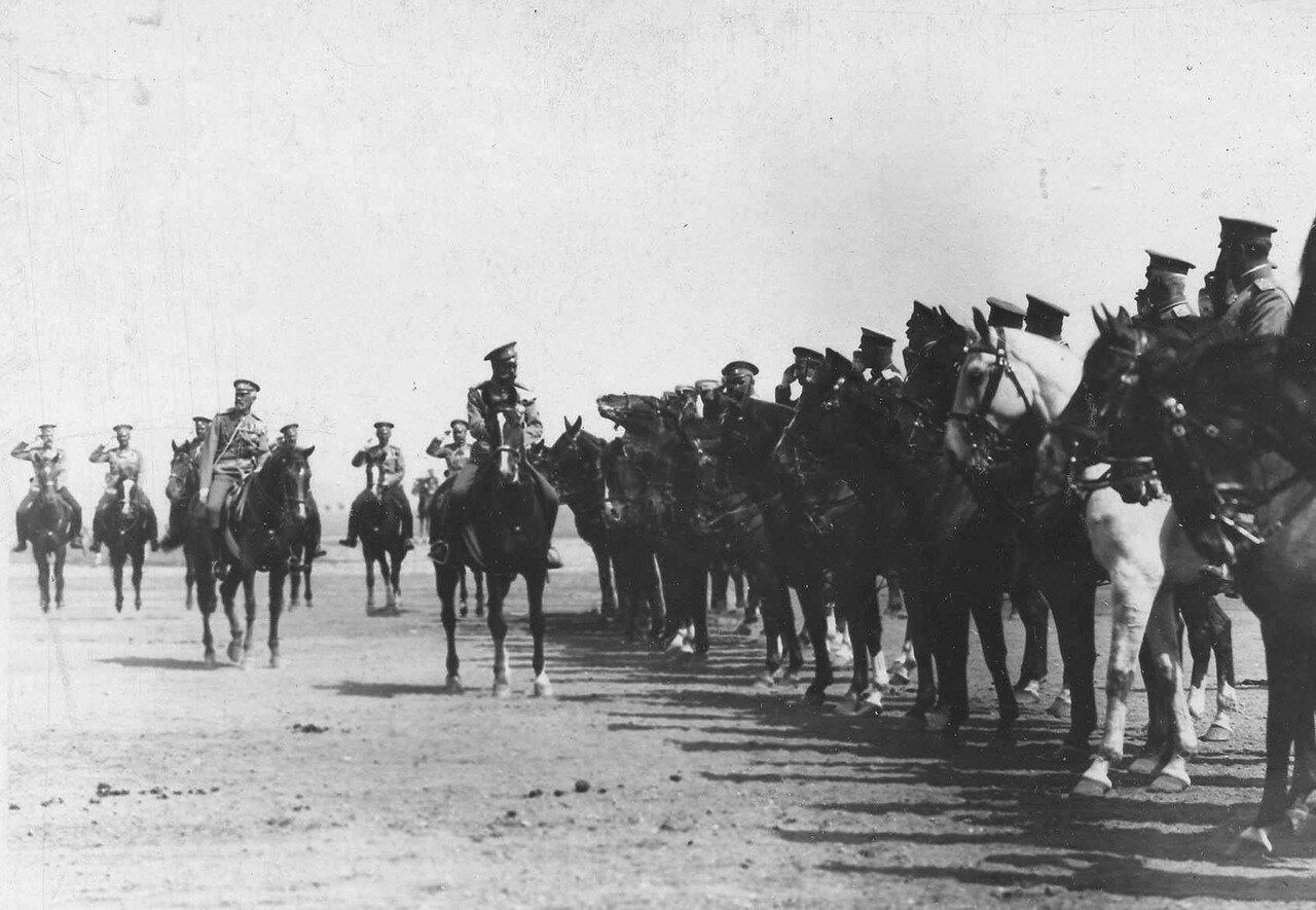 104. Император Николай II объезжает конный строй на плацпараде, слева - великий князь Николай Николаевич
