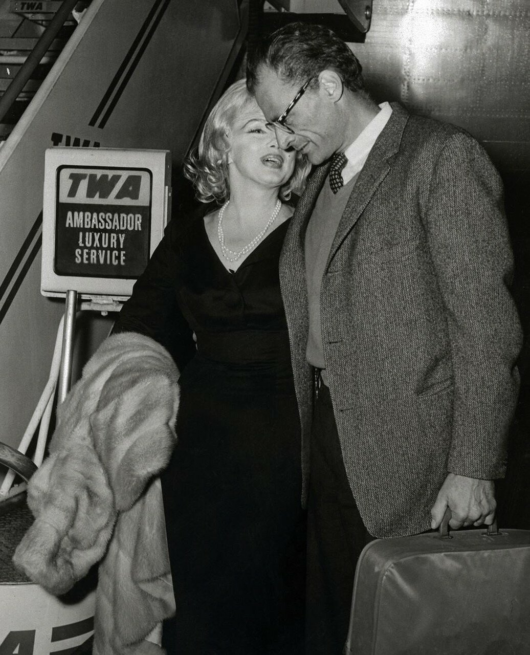 Actress Marilyn Monroe Whispering into Husbands Ear