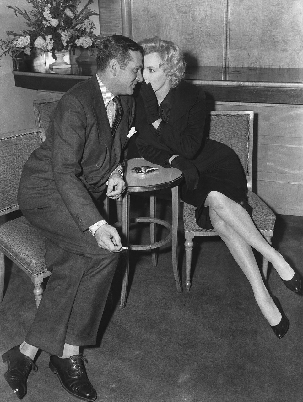 Marilyn Monroe Whispers to Laurence Olivier