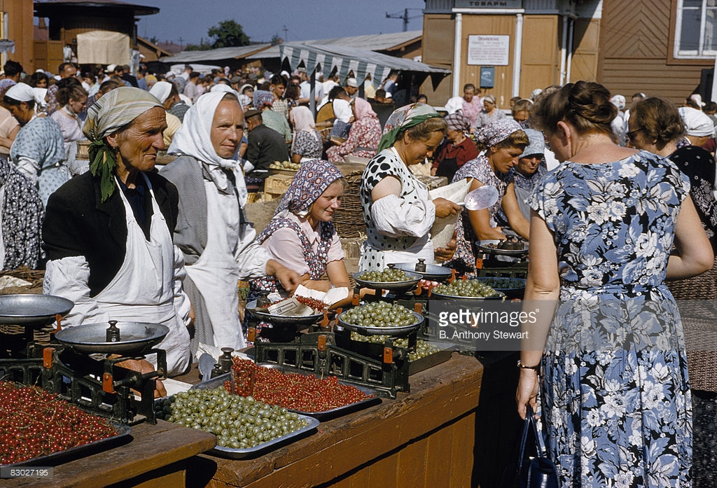 1959 Aproned women at market counters sell currants and gooseberries, Moscow by Anthony Stewart.jpg