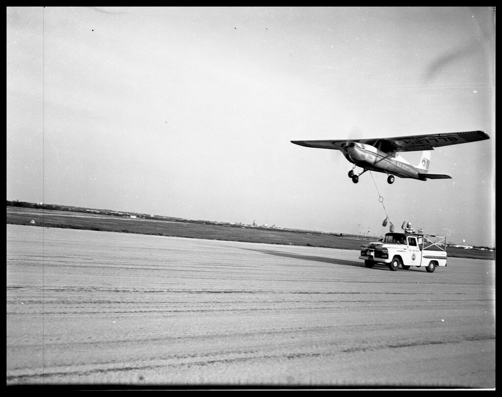 Refueling Airplane N8777B flying above a truck on a runway. Texas - Taylor County - Abilene, 1958 (7).jpg
