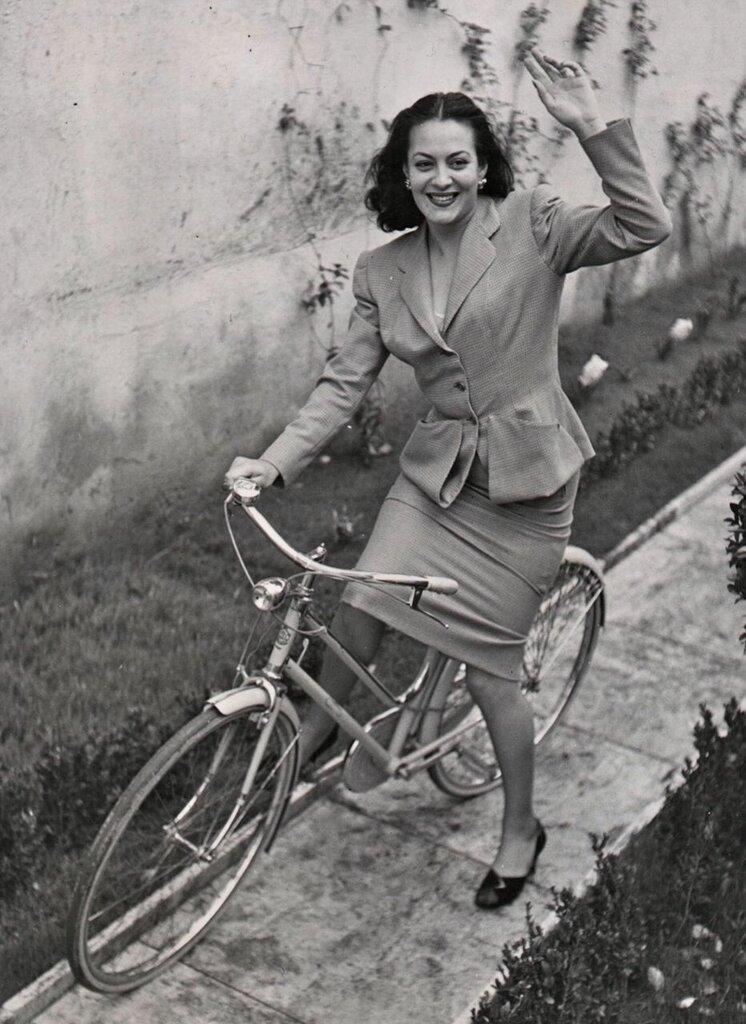 Yvonne Sanson rides a bike.jpg