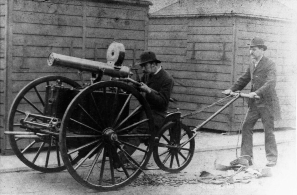 Gatling machine gun. Mounted on a three-wheeled limber, hand-drawn. Photo received by the Bureau of Ordnance, 1885
