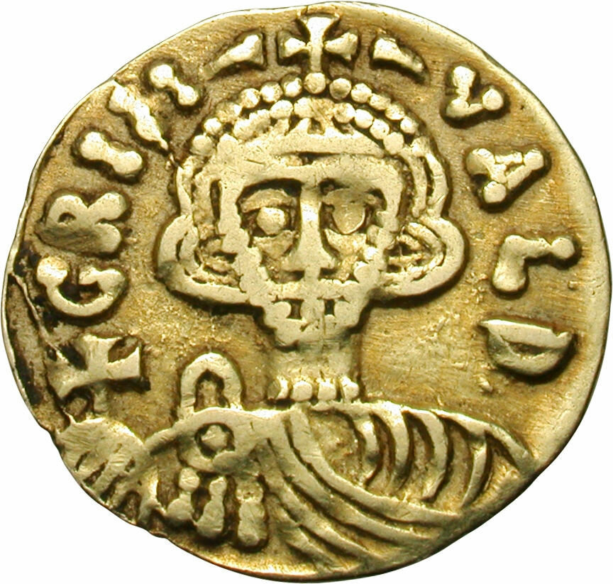 A gold tremissis, circa 788-806 AD, from the time of Grimoald III, the Lombard Prince of Benevento in Dark Ages Italy. Tremissis was a currency in the later era of ancient Rome..jpg