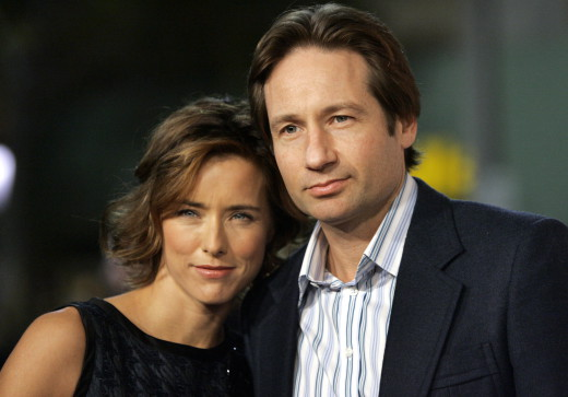 Tea Leoni and her husband David Duchovny attend the premiere of Fun with Dick and Jane in Los Angeles