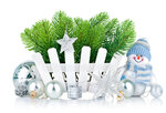 christmas tree with snowman and silvery balls isolated on