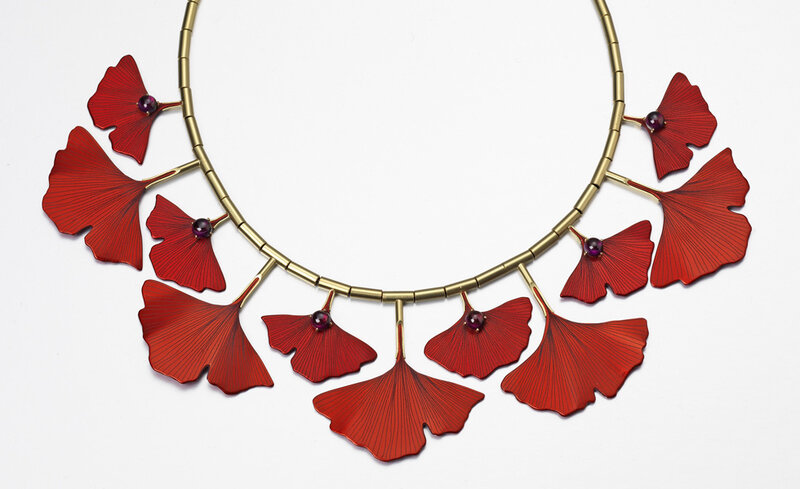Roger Doyle - Ginkgo Necklace made from 18ct yellow gold set with Rhodonite garnets mounted on photo etched red anodized aluminium