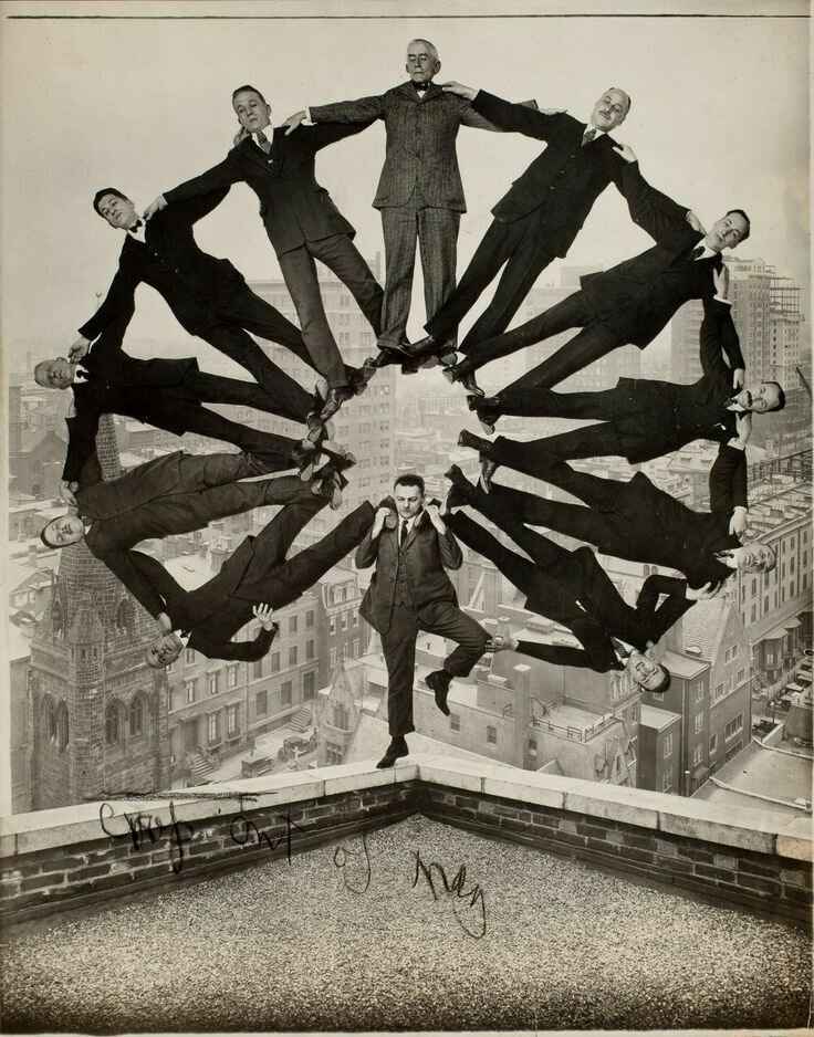 Man on Rooftop with Eleven Men in Formation on His Shoulders, Photographer Unknown, c. 1930.jpg