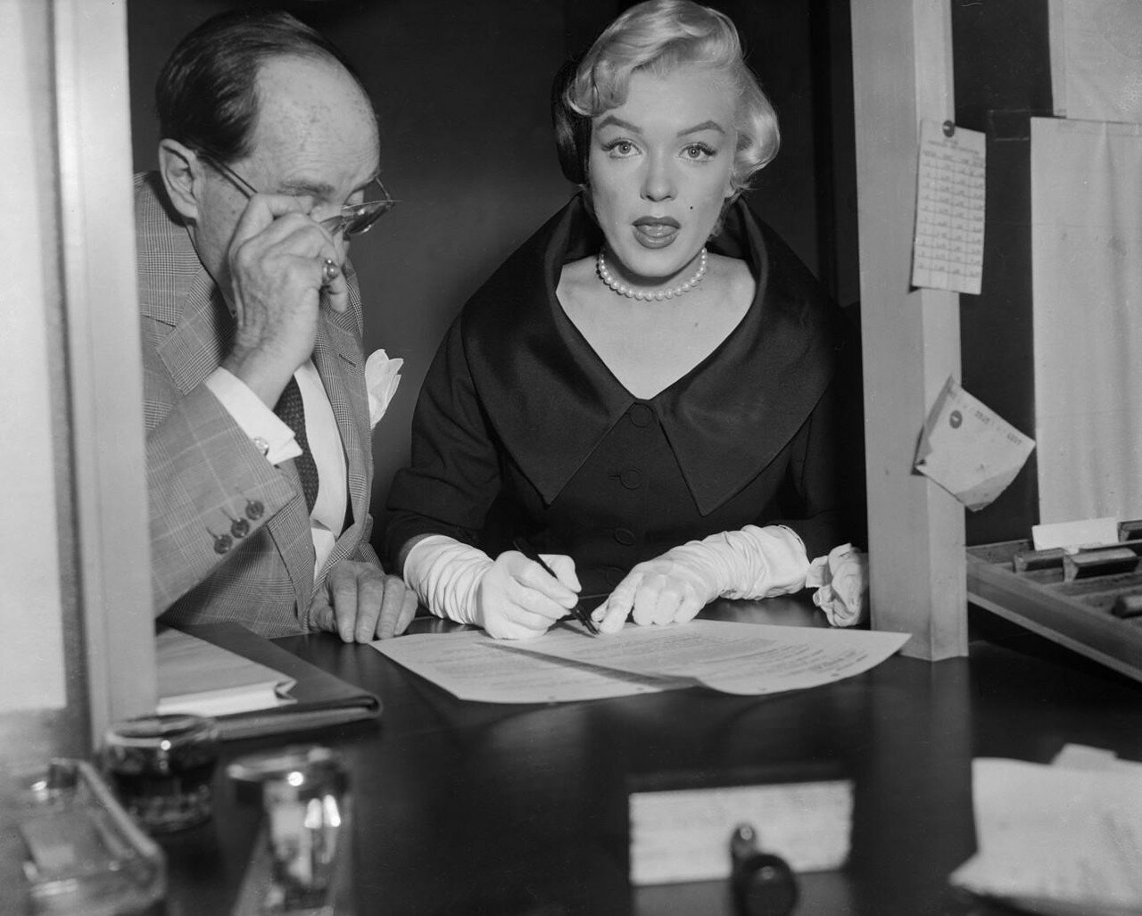 Marilyn Monroe Signing Papers