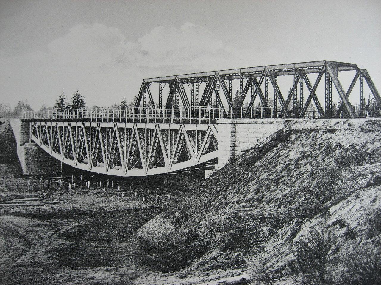 19. 2444 верста. Вид на мост через р. Окульшет. Строительный период 1910
