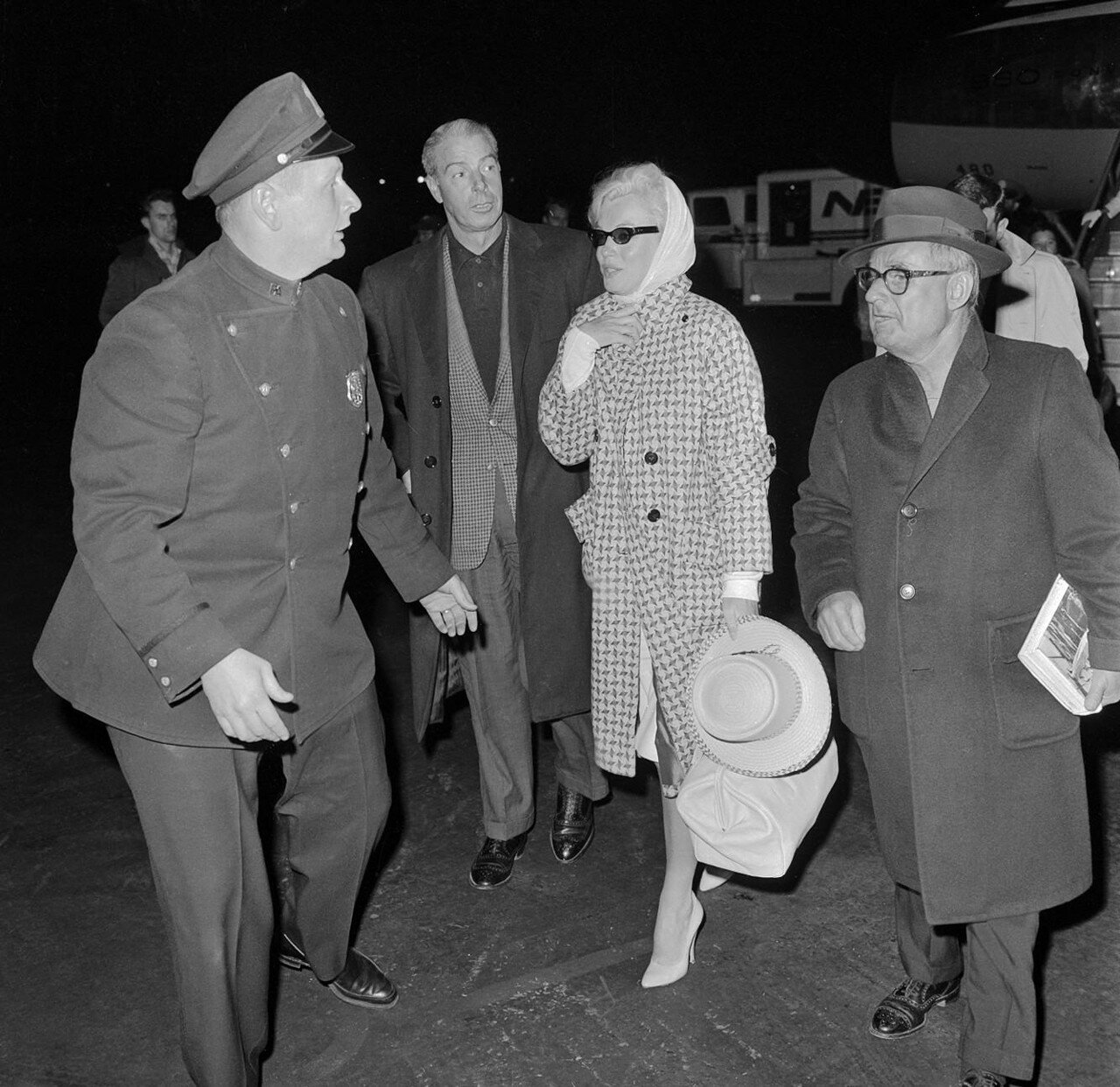 Marilyn Monroe and Joe DiMaggio Walking at Airport
