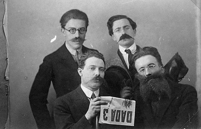 André Breton, René Hilsum, Louis Aragon and Paul Eluard posing with a copy of Dada 3, 1919.jpg