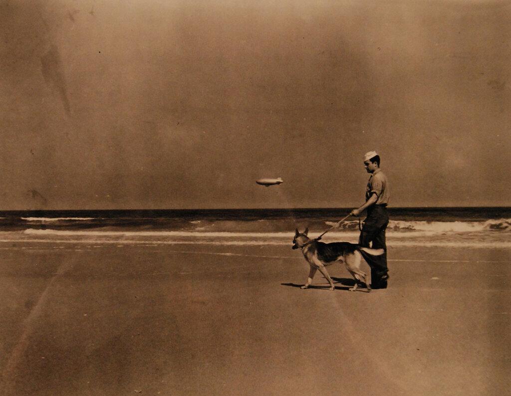 U.S. Navy Coast Patrol, sailor with dog, circa WWII